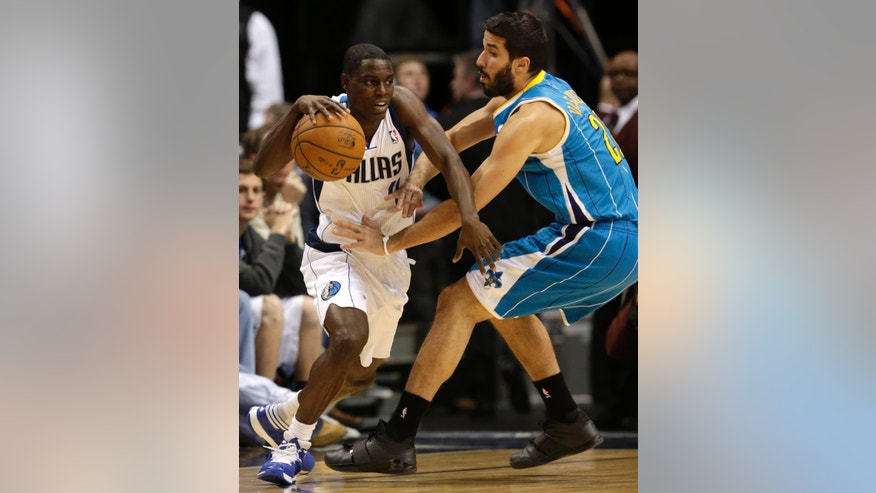 Dallas Mavericks point guard Darren Collison (4) drives against New Orleans Hornets point guard Greivis Vasquez (21) during the first half of an NBA basketball game Saturday, Jan. 5, 2013, in Dallas. (AP Photo/LM Otero)
