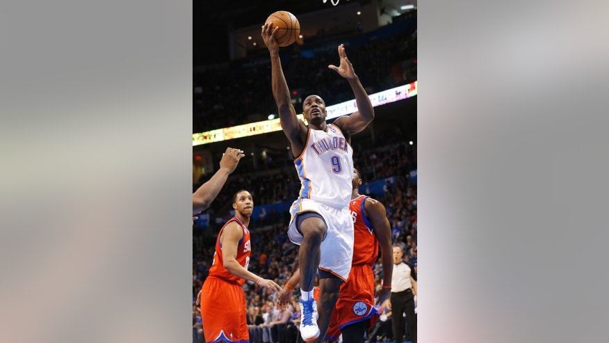 Oklahoma City Thunder forward Serge Ibaka shoots against the Philadelphia 76ers in the third quarter of an NBA basketball game in Oklahoma City, Friday, Jan. 4, 2013. Oklahoma City won 109-85. (AP Photo/Sue Ogrocki)