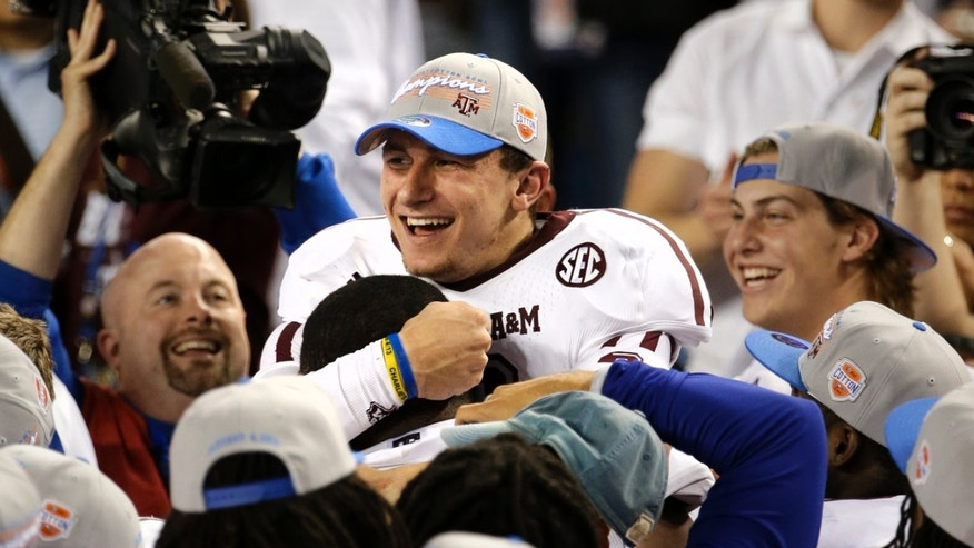 Texas A&M quarterback Johnny Manziel celebrates with teammates after their 41-13 win over Oklahoma in the Cotton Bowl NCAA college football game Friday, Jan. 4, 2013, in Arlington, Texas. (AP Photo/Tony Gutierrez)