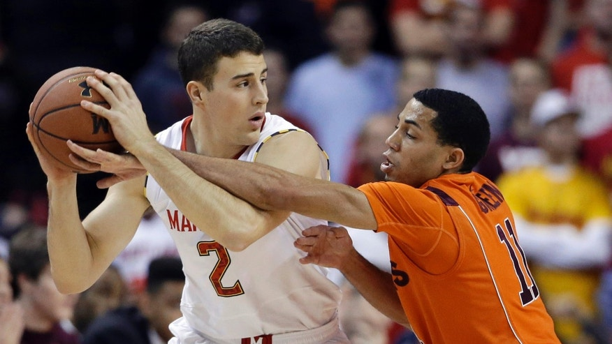 Maryland guard Logan Aronhalt, left, protects the ball as he is pressured by Virginia Tech guard Erick Green during the first half of an NCAA college basketball game in College Park, Md., Saturday, Jan. 5, 2013. (AP Photo/Patrick Semansky)