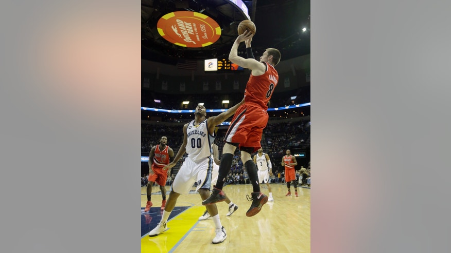 Portland Trail Blazers' Luke Babbitt (8)  shoots over Memphis Grizzlies' Darrell Arthur (00) during the first half of an NBA basketball game in Memphis, Tenn., Friday, Jan. 4, 2013. (AP Photo/Danny Johnston)