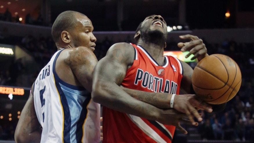 Portland Trail Blazers' J.J. Hickson, right, is fouled by Memphis Grizzlies' Marreese Speights (5) during the first half of an NBA basketball game in Memphis, Tenn., Friday, Jan. 4, 2013. (AP Photo/Danny Johnston)