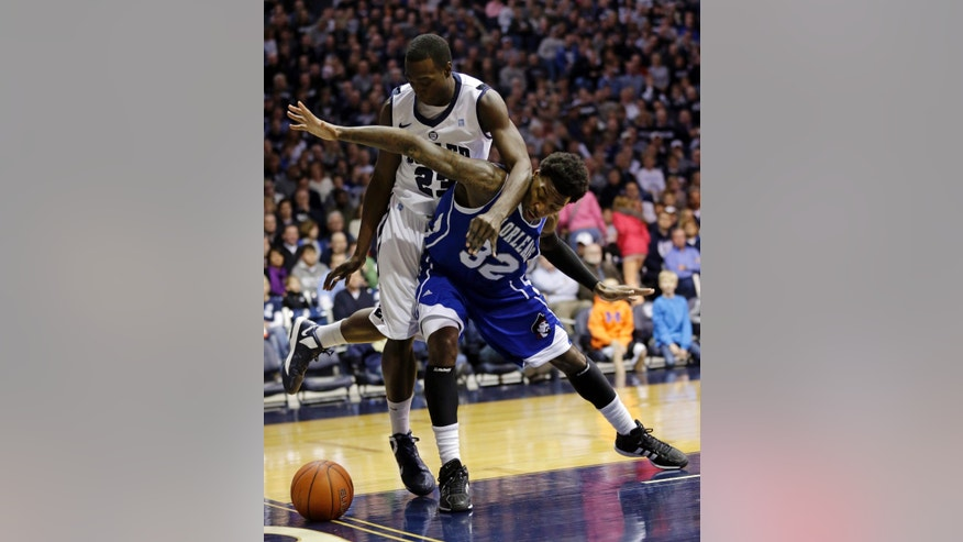 New Orleans forward Lovell Cook, front, blocks out Butler forward Khyle Marshall in the first half of an NCAA college basketball game, Saturday, Jan. 5, 2013, in Indianapolis. (AP Photo/Michael Conroy)