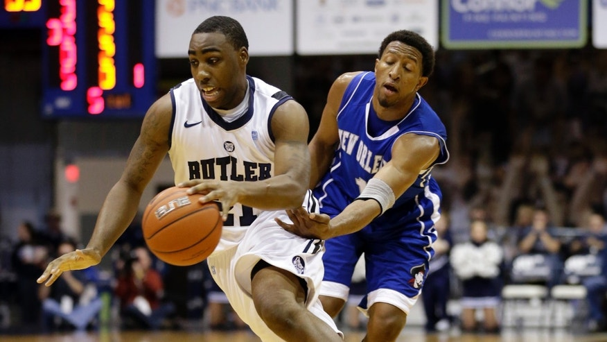Butler forward Roosevelt Jones, left, drives past New Orleans guard Corey Blake during the first half of an NCAA college basketball game, Saturday, Jan. 5, 2013, in Indianapolis. (AP Photo/Michael Conroy)
