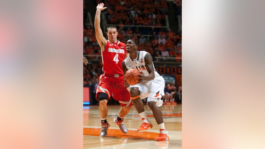 Illinois' Brandon Paul moves into shoot past Ohio State defender Aaron Craft (4) during the first half an NCAA college basketball game on Saturday, Jan. 5, 2013, in Champaign, Ill. (AP Photo/Darrell Hoemann)