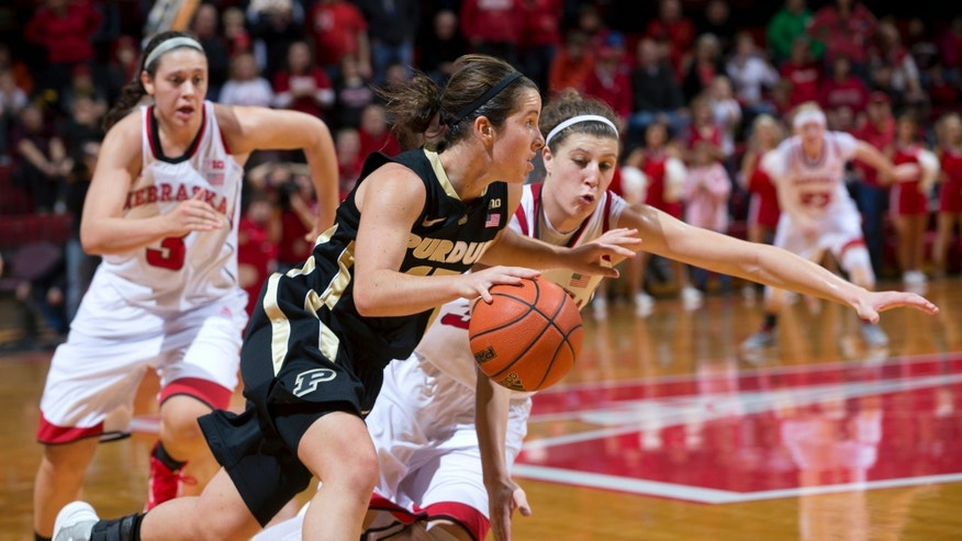 Nebraska's Jordan Hooper, right, and Hailie Sample (3) chase Purdue's Courtney Moses late in the second half of an NCAA college basketball game Saturday, Jan. 5, 2013, in Lincoln, Neb. Purdue beat Nebraska in overtime, 69-66. (AP Photo/The Omaha World-Herald, Mark Davis)  MAGS OUT   local TV OUT