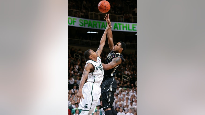 Purdue's Terone Johnson, right, shoots against Michigan State's Keith Appling during the first half of an NCAA college basketball game, Saturday, Jan. 5, 2013, in East Lansing, Mich. (AP Photo/Al Goldis)