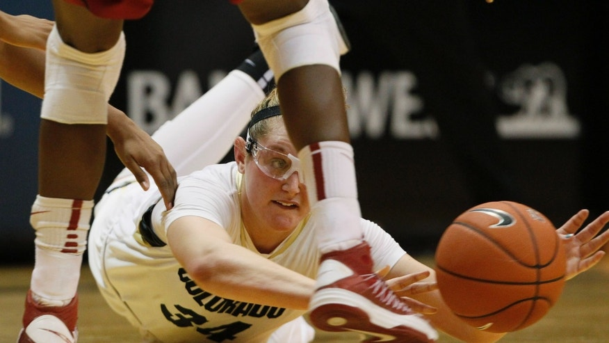 Colorado forward Jen Reese dives after a loose ball in the second half of Stanford's 57-40 victory over Colorado in an NCAA college basketball game in Boulder, Colo., on Friday, Jan. 4, 2013. (AP Photo/David Zalubowski)