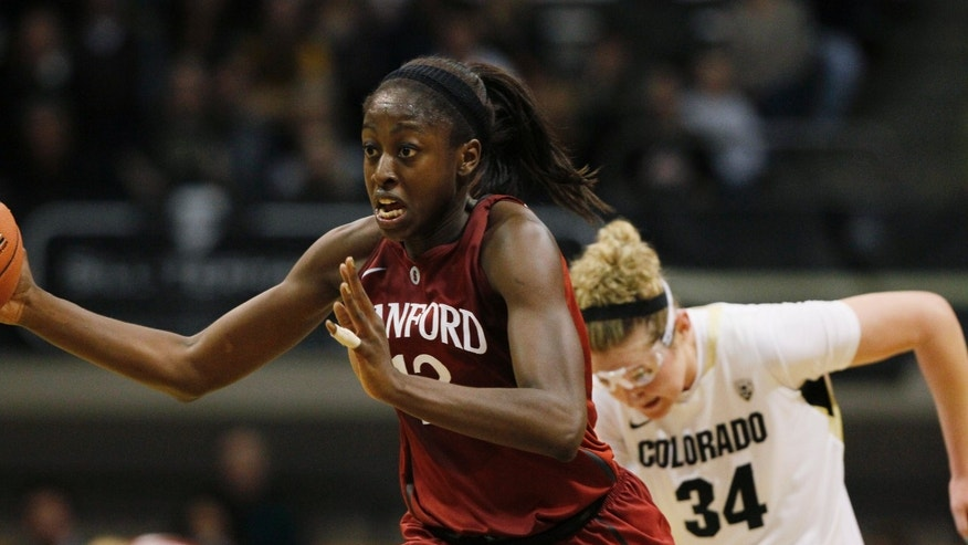 Stanford forward Chiney Ogwumike, front, reaches out to pick up a loose ball as Colorado forward Jen Reese trails in the second half of Stanford's 57-40 victory in an NCAA college basketball game in Boulder, Colo., on Friday, Jan. 4, 2013. (AP Photo/David Zalubowski)