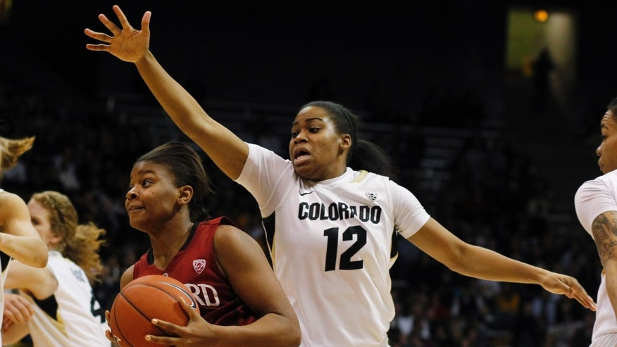 Stanford guard Amber Orrange, left, drives the lane past Colorado guard Ashley Wilson in the second half of Stanford's 57-40 victory in an NCAA college basketball game in Boulder, Colo., on Friday, Jan. 4, 2013. (AP Photo/David Zalubowski)