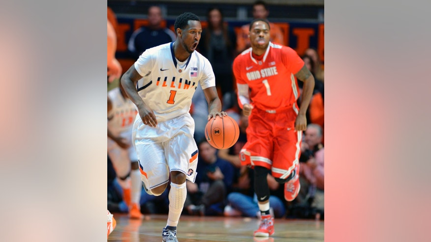 Illinois guard D.J. Richardson, left, shouts to teammates as he brings the ball downcourt during the first half an NCAA college basketball game against Ohio State on Saturday, Jan. 5, 2013, in Champaign, Ill. (AP Photo/Darrell Hoemann)