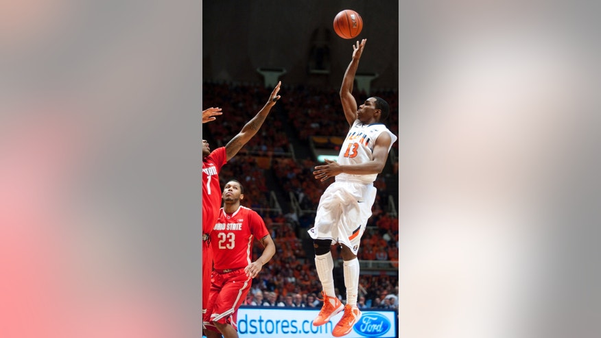 Illinois guard Tracy Abrams (13) shoots and scores during the first half an NCAA college basketball game against Ohio State on Saturday, Jan. 5, 2013, in Champaign, Ill. (AP Photo/Darrell Hoemann)