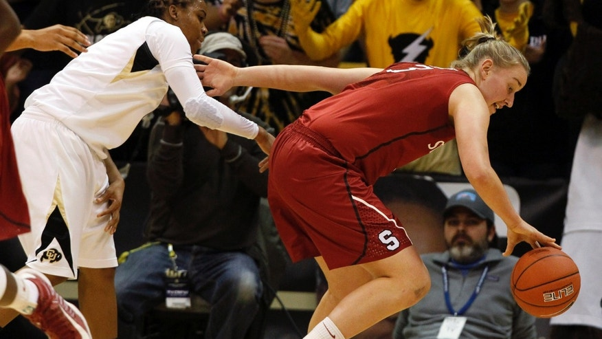 Stanford forward Mikaela Ruff, right, reaches out for a loose ball as Colorado guard Ashley Wilson covers in the first half of an NCAA women's college basketball game in Boulder, Colo., on Friday, Jan. 4, 2013. (AP Photo/David Zalubowski)