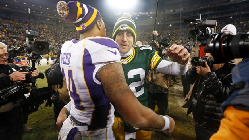 Jan. 5, 2013: Green Bay Packers quarterback Aaron Rodgers (12) hugs Minnesota Vikings quarterback Joe Webb (14) after  an NFL wild card playoff football game.