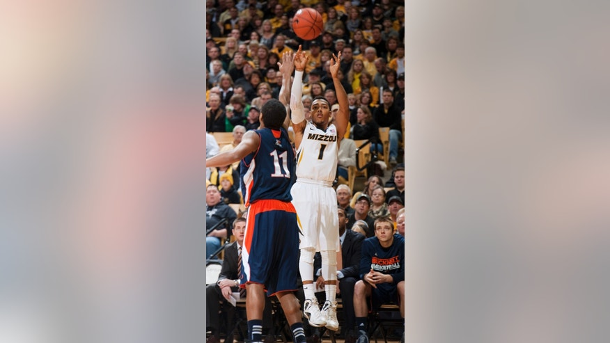Missouri's Phil Pressey, right, shoots over Bucknell's Ryan Hill, left, during the first half of an NCAA college basketball game Saturday, Jan. 5, 2013, in Columbia, Mo. Missouri won the game 66-64. Pressey had a game high 26 points in the game. (AP Photo/L.G. Patterson)
