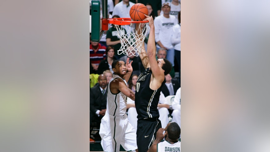 Purdue's A.J. Hammons dunks against Michigan State's Gary Harris, left, and Branden Dawson, right, during the first half of an NCAA college basketball game, Saturday, Jan. 5, 2013, in East Lansing, Mich. Michigan State won 84-61.(AP Photo/Al Goldis)