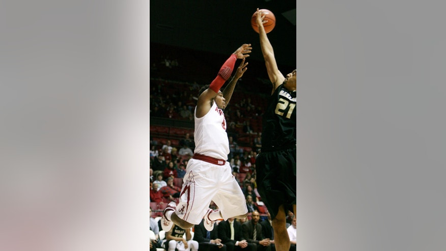 Oakland forward Raphael Carter (21) reaches to block Alabama guard Trevor Lacey (5) during an NCAA college basketball game at Coleman Coliseum in Tuscaloosa, Ala., Saturday, Jan. 5, 2013. (AP Photo/Tuscaloosa News, Michelle Lepianka Carter)