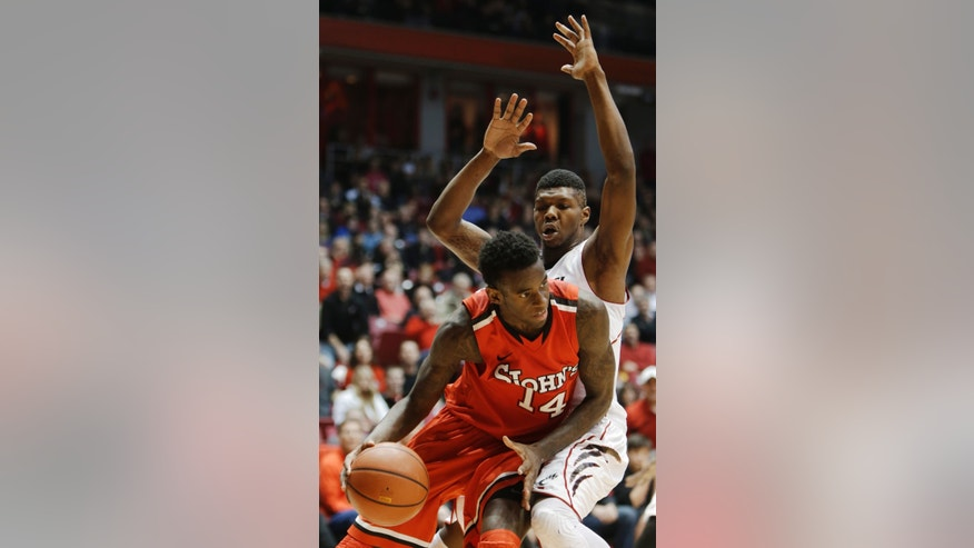 St. John's forward Jakarr Sampson (14) drives against Cincinnati forward Titus Rubles in the second half of an NCAA college basketball game, Saturday, Jan. 5, 2013, in Cincinnati. Sampson led St. John's to a 53-52 win with 16 points. (AP Photo/Al Behrman)