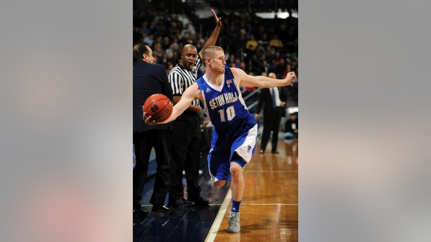 Seton Hall guard Kyle Smyth saves the ball from going out of bounds during the first half of an NCAA college basketball game against Notre Dame, Saturday, Jan. 5, 2013, in South Bend, Ind.  (AP Photo/Joe Raymond)