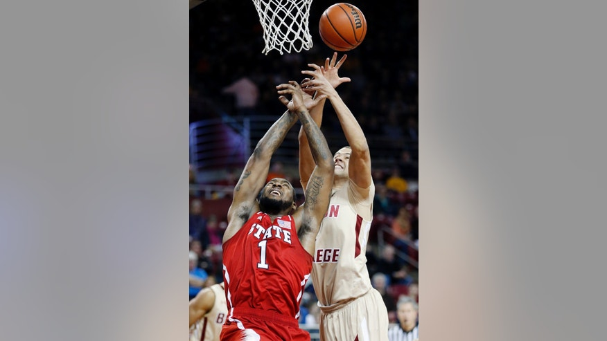 Boston College's Ryan Anderson, right, blocks a shot by North Carolina State's Richard Howell (1) in the first half of an NCAA college basketball game in Boston, Saturday, Jan. 5, 2013. (AP Photo/Michael Dwyer)