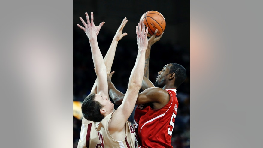 North Carolina State's C.J. Leslie (5) shoots over Boston College's Dennis Clifford, left, in the first half of an NCAA college basketball game in Boston, Saturday, Jan. 5, 2013. (AP Photo/Michael Dwyer)