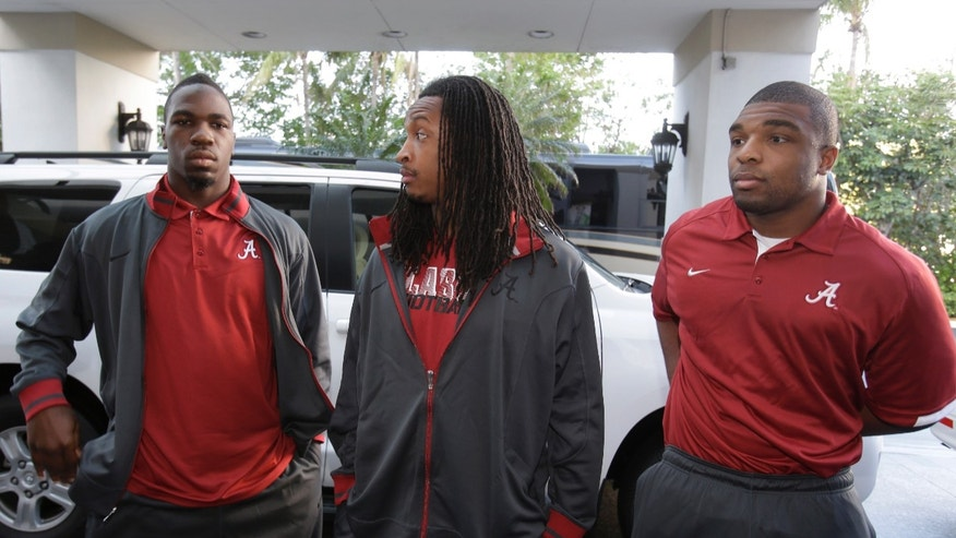 Alabama linebacker C.J. Mosley, left, defensive back Robert Lester, center, and linebacker Nico Johnson, right wait to enter the Harbor Beach Marriott Resort and Spa for a media availability, Friday, Jan. 4, 2013 in Fort Lauderdale, Fla. Alabama is scheduled to play Notre Dame on Monday, Jan. 7, in the BCS national championship NCAA college football game. (AP Photo/Wilfredo Lee)