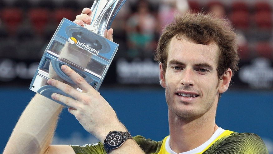Andy Murray of Britain holds the winner's trophy after winning the men's final match against Grigor Dimitrov of Bulgaria 7-6, 6-4 during the Brisbane International tennis tournament in Brisbane, Australia, Sunday, Jan 6, 2013.  (AP Photo/Tertius Pickard).