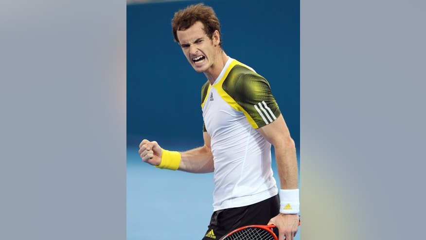 Andy Murray of Britain celebrates after winning the men's final match against Grigor Dimitrov of Bulgaria 7-6, 6-4 during the Brisbane International tennis tournament in Brisbane, Australia, Sunday, Jan. 6, 2013.  (AP Photo/Tertius Pickard).