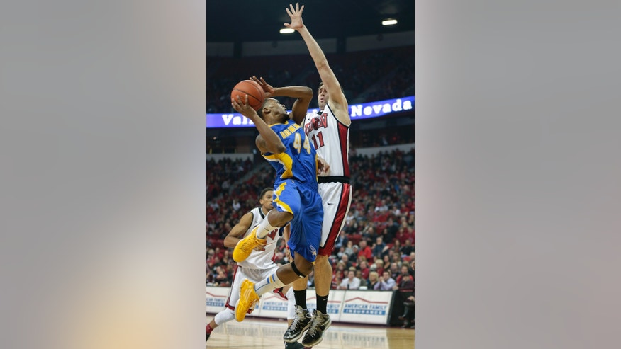 CSU Bakersfield's Stephon Carter (44) is fouled while shooting against UNLV's Carlos Lopez-Sosa during the first half of an NCAA college basketball game, Saturday, Jan. 5, 2013, in Las Vegas. (AP Photo/Julie Jacobson)