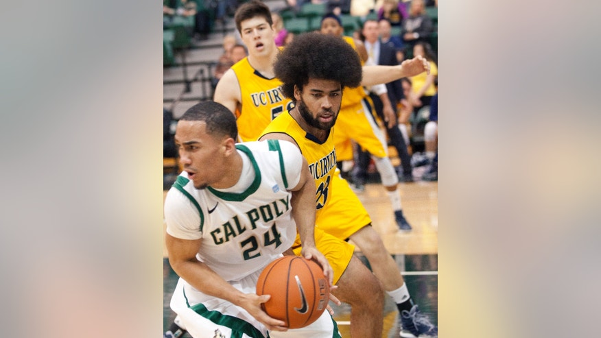 UC Irvine's Michael Wilder (23) guards Cal Poly's Chris Jamal Johnson (24)  during an NCAA college basketball game Saturday, Jan. 5, 2013, at Mott Gym in San Luis Obispo, Calif. (AP Photo/The Tribune (of San Luis Obispo),Laura Dickinson)