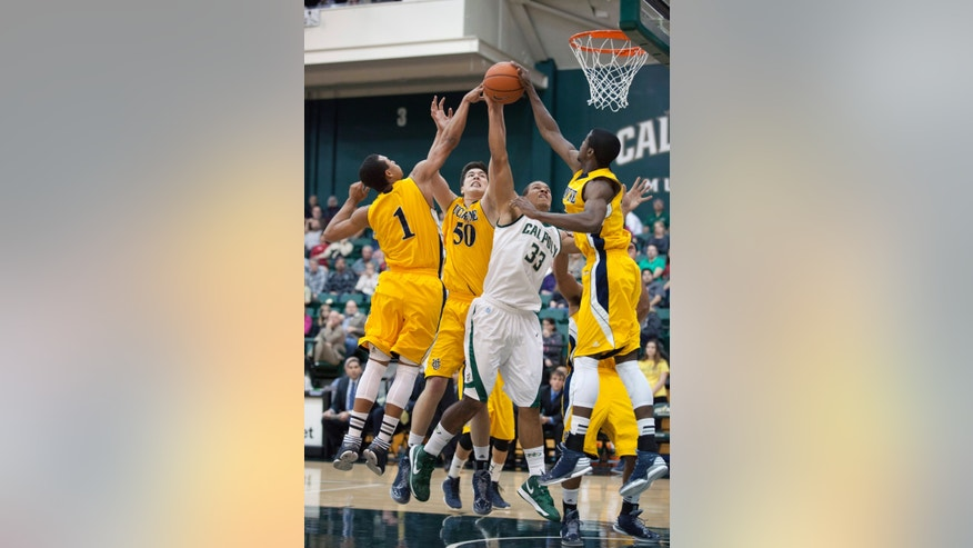 Cal Poly State's Chris Eversley (33) shoots against UC Irvine's Alex Young (1), Conor Clifford (50) and Chris NcNealy's (5) during an NCAA college basketball game Saturday, Jan. 5, 2013, at Mott Gym in San Luis Obispo, Calif. (AP Photo/The Tribune (of San Luis Obispo),Laura Dickinson)
