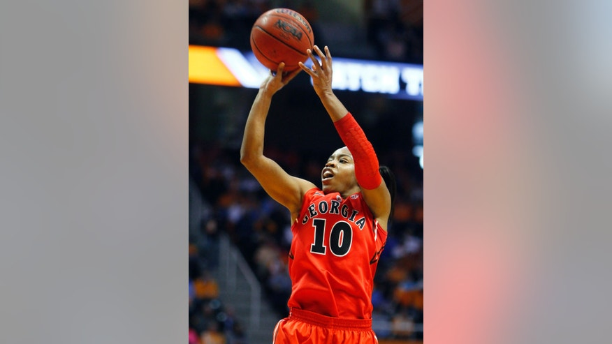 Georgia guard Jasmine James (10) shoots during the first half of an NCAA women's college basketball game against Tennessee, Sunday, Jan. 6, 2013, in Knoxville, Tenn. (AP Photo/Wade Payne)