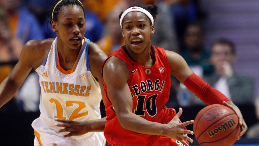 Georgia guard Jasmine James (10) drives past Tennessee center Bashaara Graves (12) during the first half of an NCAA women's college basketball game on Sunday, Jan. 6, 2013, in Knoxville, Tenn. (AP Photo/Wade Payne)