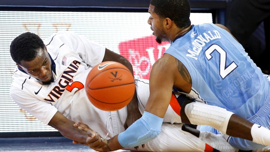 Virginia's Teven Jones, left, and North Carolina's Leslie McDonald scramble for a loose ball during an NCAA college basketball game in Charlottesville, Va., on Sunday, Jan. 6, 2013. (AP Photo/ Richmond Times-Dispatch, Dean Hoffmeyer)