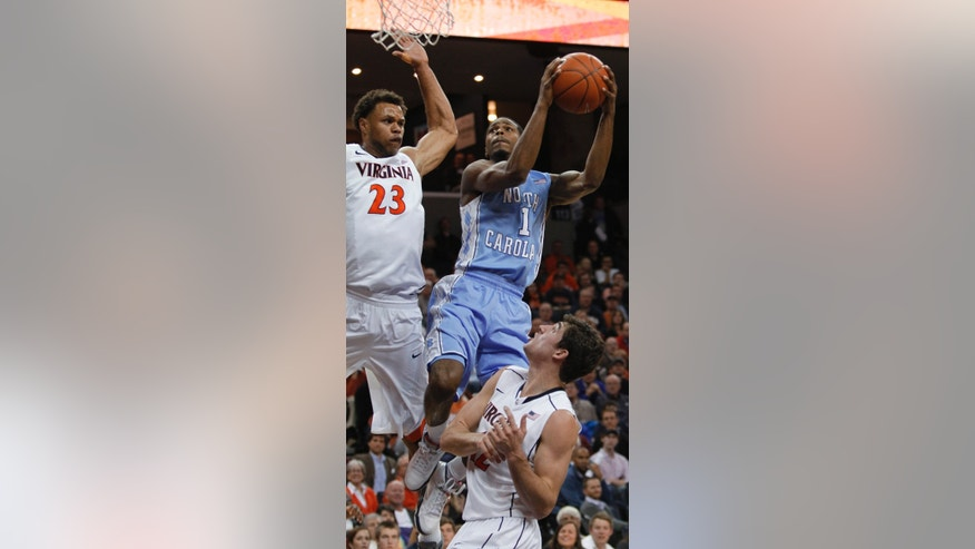 North Carolina guard Dexter Strickland shoots next to Virginia guard Justin Anderson, left, as Virginia's Joe Harris watches in the first half of an NCAA college basketball game in Charlottesville, Va., Sunday, Jan. 6, 2013. (AP Photo/Norm Shafer)