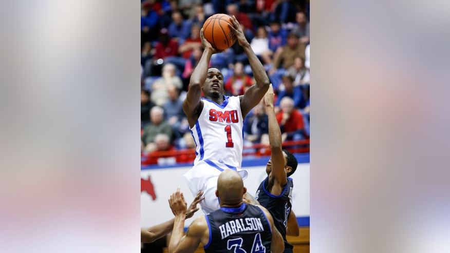 SMU's Ryan Manuel (1) takes the ball to the rim against Tulsa during an NCAA college basketball game in Dallas, Sunday, Jan. 6, 2013. (AP Photo/The Dallas Morning News, Stan Olszewski) MANDATORY CREDIT; MAGS OUT; TV OUT; INTERNET OUT; AP MEMBERS ONLY.