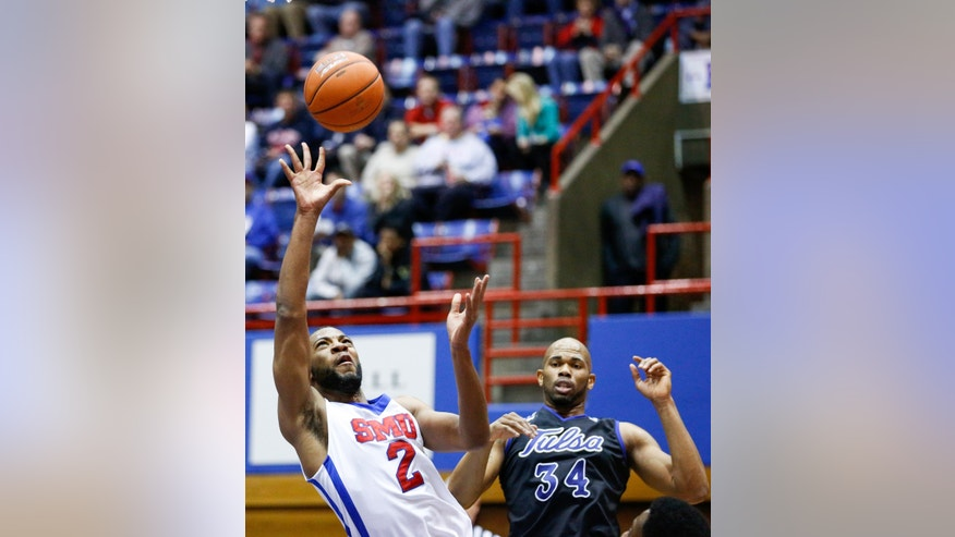 SMU's Shawn Williams (2) takes the ball to the rim against a Tulsa defender in Dallas, Sunday, Jan. 6, 2013.  (AP Photo/The Dallas Morning News, Stan Olszewski) MANDATORY CREDIT; MAGS OUT; TV OUT; INTERNET OUT; AP MEMBERS ONLY.