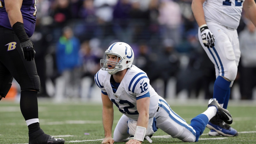 Indianapolis Colts quarterback Andrew Luck (12) gets up from the turf during the second half of an NFL wild card playoff football game against the Baltimore Ravens Sunday, Jan. 6, 2013, in Baltimore. The Ravens won 24-9. (AP Photo/Patrick Semansky)