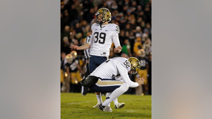 FILE - In this Nov. 3, 2012, file photo, Pittsburgh kicker Kevin Harper (39) and holder Matt Yoklic react after Harper missed what would have been the game-winning field goal in the second overtime period against Notre Dame in an NCAA college football game in South Bend, Ind. No. 1 Notre Dame enjoyed its share of fortunate breaks on its way to the BCS title game scheduled for Monday, Jan. 7, 2013, with perhaps the bulk of those coming during a wild game at home against Pittsburgh. And without those breaks, Notre Dame would be out of the title chase. (AP Photo/Michael Conroy, File)