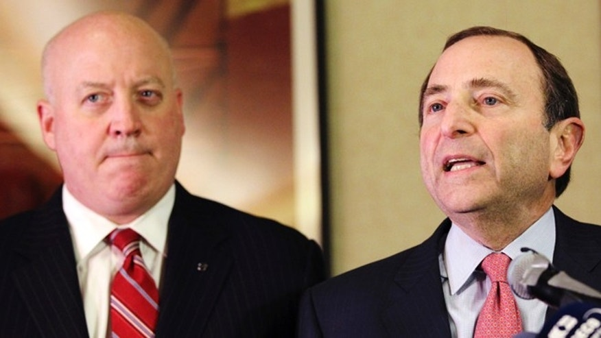 Dec. 6, 2012: NHL Commissioner Gary Bettman, right, and deputy commissioner Bill Daly speak to reporters in New York.