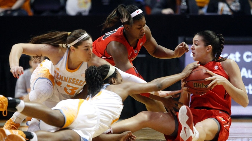 Georgia forward Anne Marie Armstrong, right, battles for the ball with Tennessee center Isabelle Harrison, front, Taber Spani (13) and teammate Jasmine James (10) during the first half of an NCAA women's college basketball game on Sunday, Jan. 6, 2013, in Knoxville, Tenn. (AP Photo/Wade Payne)