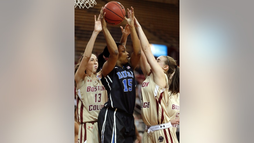 Duke forward Richa Jackson (15), center, vies for control of the ball with Boston College forward Alexa Coulombe (13), left, and guard Nicole Boudreau (11), right, in the first half of an NCAA college basketball game at Boston College in Boston, Sunday, Jan. 6, 2013. (AP Photo/Steven Senne)