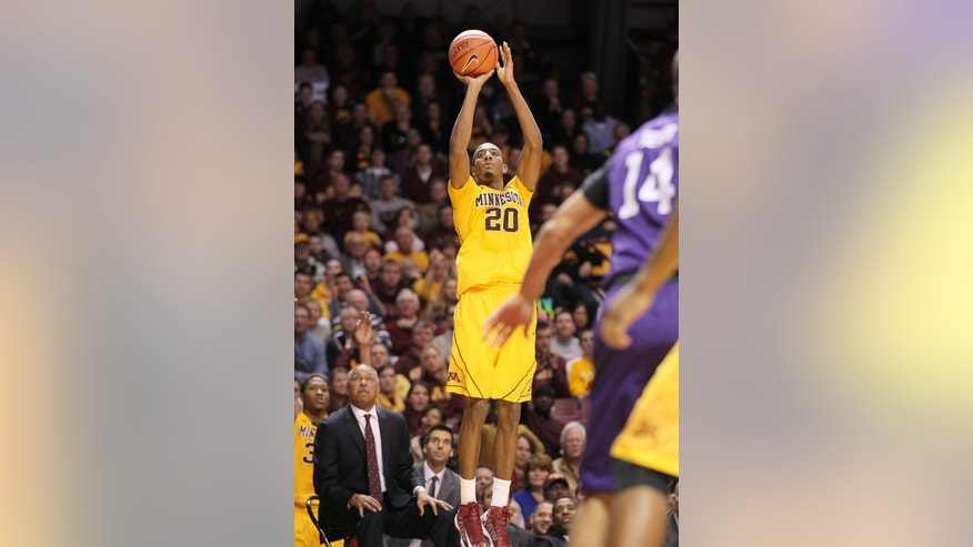 Minnesota guard Austin Hollins shoots a 3-pointer against Northwestern during the second half of an NCAA college basketball game, Sunday, Jan. 6, 2013, in Minneapolis. (AP Photo/Andy King)