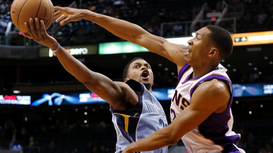 Memphis Grizzlies' Rudy Gay has his shot blocked by Phoenix Suns' Wesley Johnson, right, during the first half of an NBA basketball game, Sunday, Jan. 6, 2013, in Phoenix. (AP Photo/Matt York)