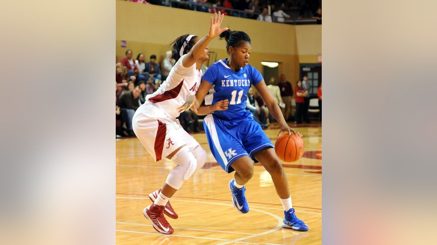 Kentucky's DeNesha Stallworth (11) drives to the basket past Alabama's Kaneisha Horn (40) during the second half of their NCAA women's college basketball game in Tuscaloosa, Ala., Sunday, Jan. 6, 2013. (AP Photo /Jason Harless)
