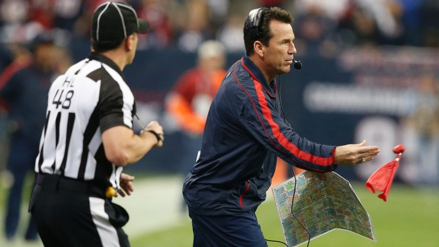 Houston Texans head couch Gary Kubiak throws the red flag during the second half of an NFL AFC Playoff football game Saturday, Jan. 5, 2013, in Houston, Texas. (AP Photo/Waco Tribune Herald/ Jose Yau)