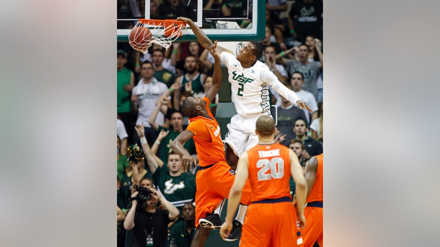 COIRRECTS YEAR - South Florida's Victor Rudd (2) dunks over Syracuse's Baye Keita during the first half of an NCAA college basketball game Sunday, Jan. 6, 2013, in Tampa, Fla. (AP Photo/Mike Carlson)