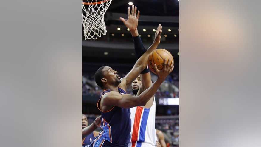 Charlotte Bobcats guard Ben Gordon, left, gets a shot off against Detroit Pistons forward Andre Drummond in the first half of an NBA basketball game, Sunday, Jan. 6, 2013, in Auburn Hills, Mich. (AP Photo/Duane Burleson)