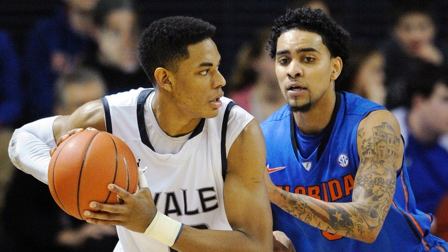 Yale's Armani Cotton, left is guarded by Florida's Mike Rosario during the first half of an NCAA college basketball game in New Haven, Conn., Sunday, Jan. 6, 2013. Florida won 79-58. (AP Photo/Fred Beckham)