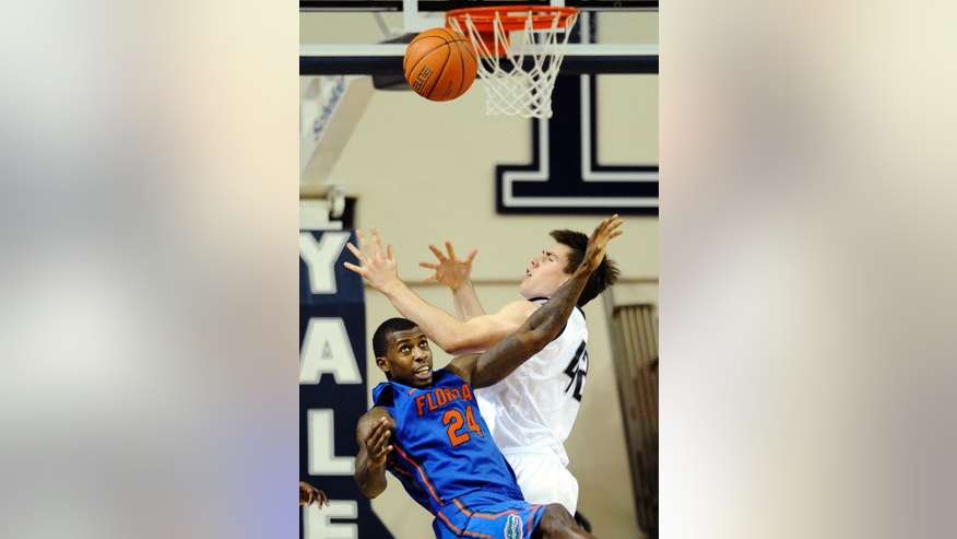 Yale's Matt Townsend (42) and Florida's Casey Prather fight for a rebound during the first second half of an NCAA college basketball game in New Haven, Conn., Sunday, Jan. 6, 2013. Florida won 79-58. (AP Photo/Fred Beckham)